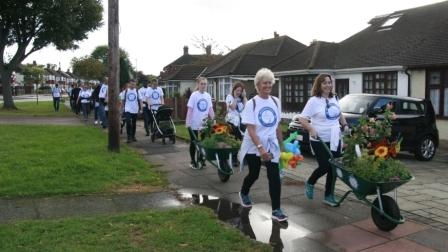 Accountants 10k hike pushing wheelbarrows of plants to raise funds for Bexley Hospice image